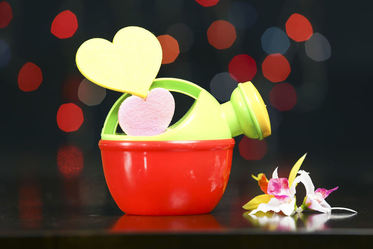 Love concepts with heart shape with light blur background Love Backgrounds Being Loved Bokeh Bokeh Photography Close-up Concept Cup Decoration Flower Fresh Love Heart Heart Shape Indoors  Light Blur Light Bokeh Love ♥ Mug No People Selective Focus Still Life Table Wallpaper