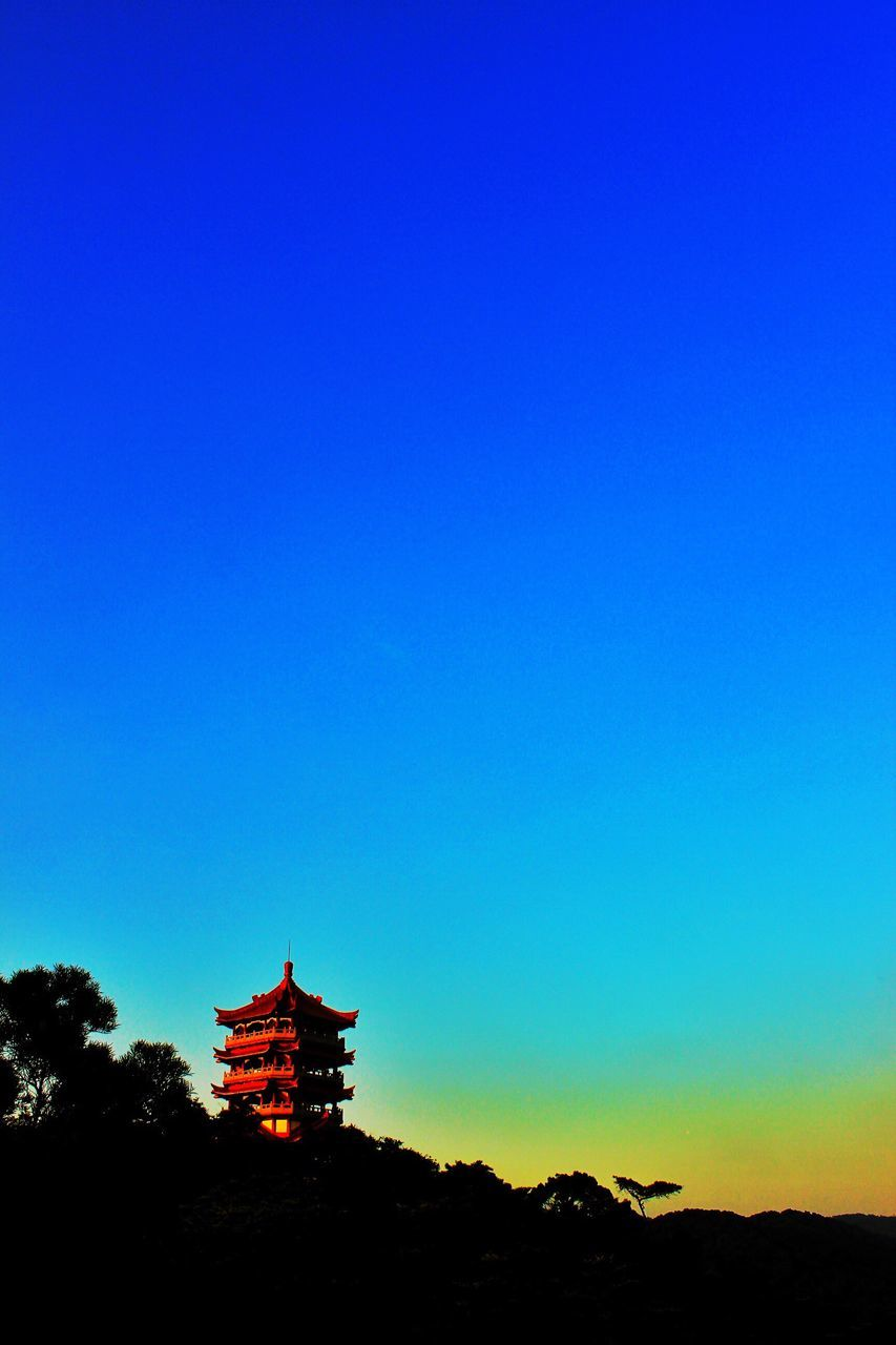 religion, place of worship, architecture, spirituality, built structure, blue, building exterior, silhouette, travel destinations, outdoors, no people, nature, clear sky, beauty in nature, sky, day, tree