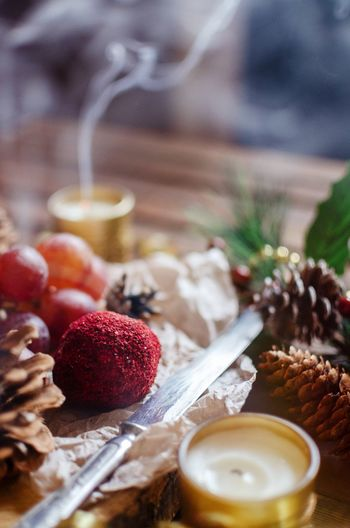 High angle view of food and pine cones on table