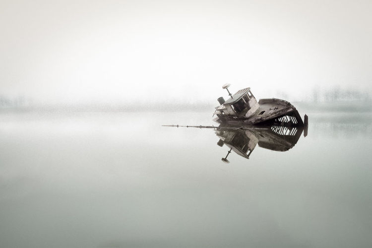 Boat on sea against sky