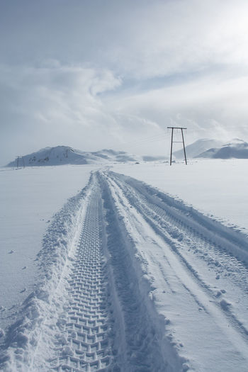 Remote Location Beauty In Nature Cold Temperature Day Field Frozen Landscape Lorry Tracks Nature No People Outdoors Patterns Sky Snow Tranquil Scene Tranquility Tyre Marks Vehicle Tracks Weather White Color Winter