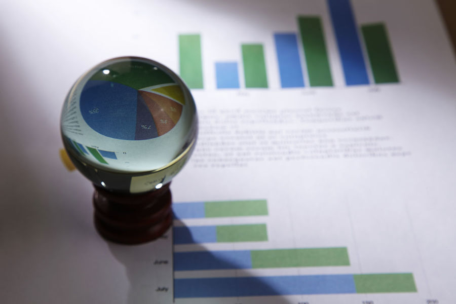 crystal ball on the business report Business Crystal Ball Economy Fortune Telling RISK Accounting Bank Chart Data Finance Forecast Foretell Fortune Future Glass - Material Graph Information Investment Investor No People Orbuculum Predict Projecting Stock Market And Exchange Studio Shot