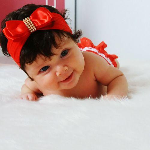 Cute baby girl lying down on rug