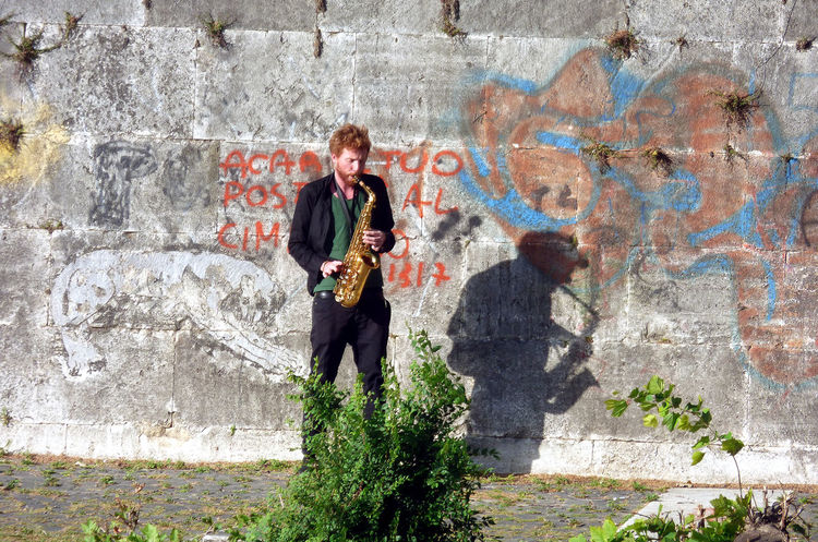 man playing sax Adult Artist Casual Clothing City Exibition Musical Instrument One Man Only One Person Only Men Sax Saxophonist Spray Paint Standing Street Art Young Adult