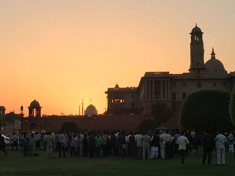 Sunset in New Delhi...the dome of the Rashtrapati Bhawan ( Presidentail Palace ) seen in the background , and the South Block , which houses several minintries , imn the foreground Architecture City Colonial Architecture Golden Glow Large Group Of People Lutyen`s Delhi New Delhi Outdoors Presidential Palace Rashtrapati Bhawan Sky South Bloc South Block Sunset Travel Destinations