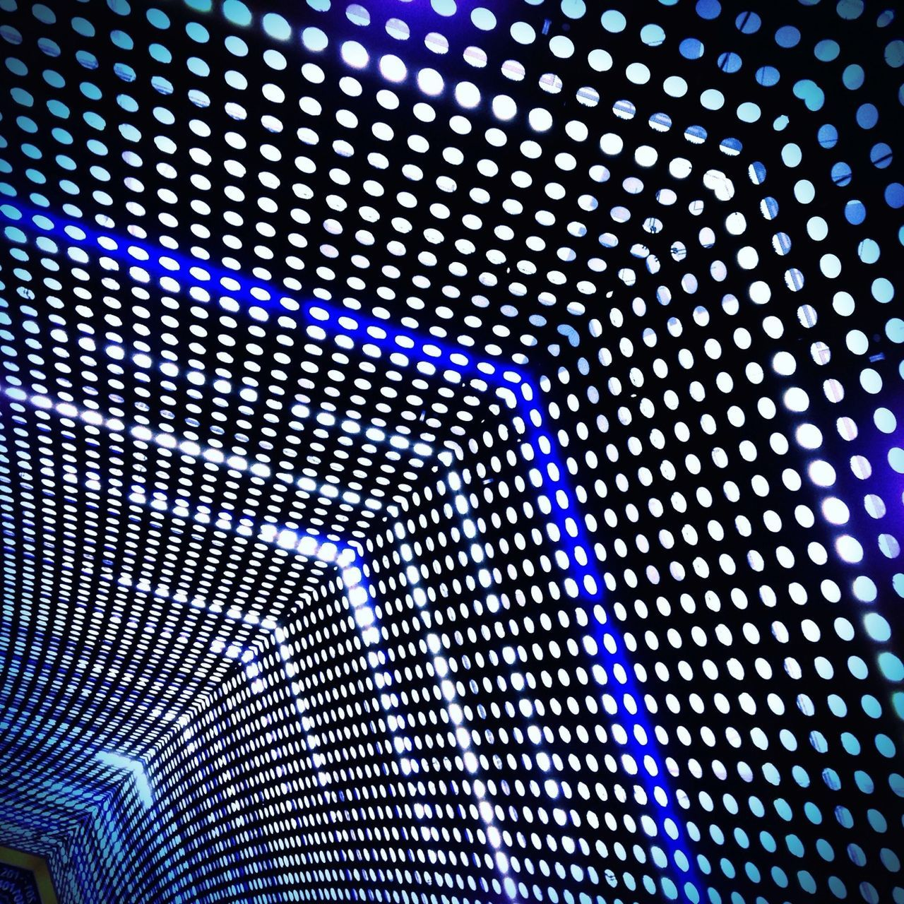 Low Angle View Of Illuminated Ceiling In Tunnel