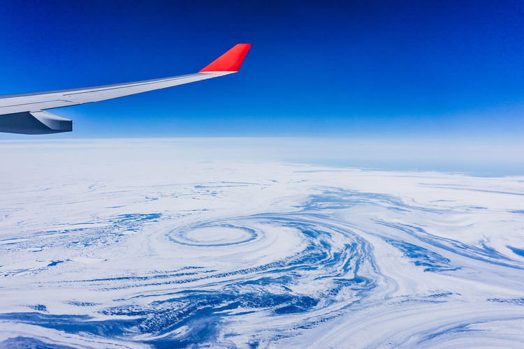 The Traveler - 2018 EyeEm Awards The Great Outdoors - 2018 EyeEm Awards Aerial View Airplane Airplane Wing Arctic Beauty In Nature Blue Circle Cold Temperature Enjoying The View Floating Flow  Flying Frozen Ice Nature Newfoundland No People Outdoors Pack Ice Sea Sky Snow Transportation Been There. Perspectives On Nature