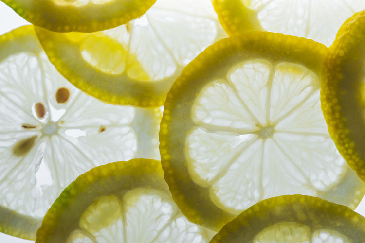 Yellow lemon slice fresh on a white background. Close-up Freshness SLICE Fruit Food Food And Drink Healthy Eating No People Still Life Wellbeing Citrus Fruit Indoors  Yellow Full Frame Lemon Backgrounds Cross Section Juicy Pattern Shape Tasty