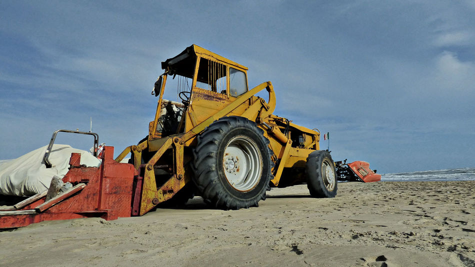 Beach Beachscape Construction Machinery Construction Site Construction Vehicle Construction Yard Day Industry Land Vehicle Large Machinery Large Machines Low Angle View Machinery No People Outdoors Road Construction Sand Seaside Sky
