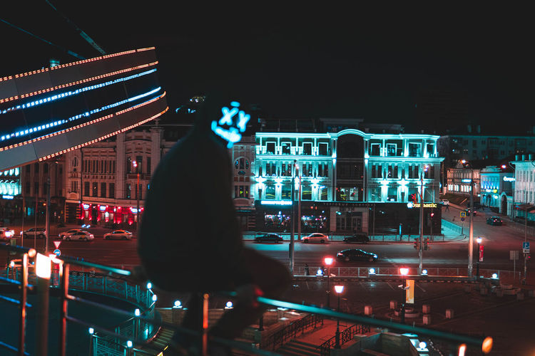 One Person Real People Lifestyles Night Illuminated Architecture Built Structure Building Exterior City Transportation Mode Of Transportation City Life Standing Leisure Activity Motion Three Quarter Length Street Sky Blurred Motion Nightlife Neon Bokeh Bokeh Photography Nightphotography Night Lights Night Photography neon life