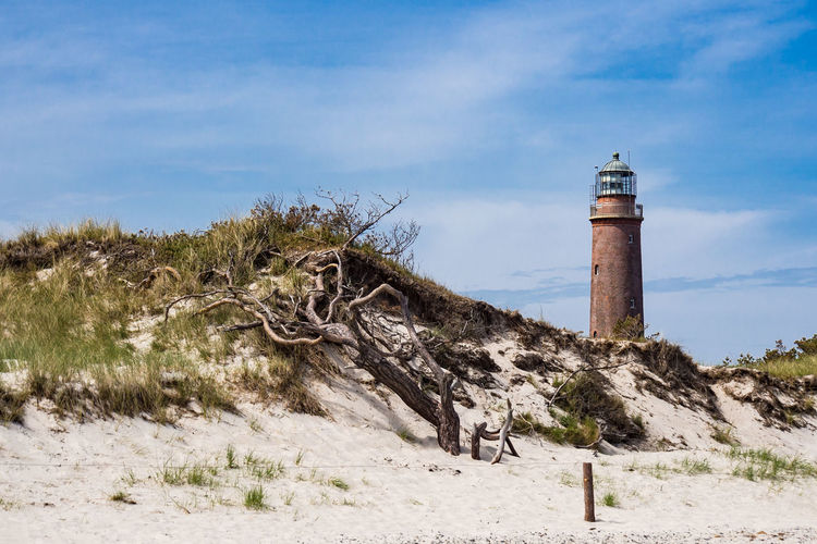 Baltic Sea coast Architecture Baltic Sea Holiday Lighthouse Relaxing Weststrand Beach Blue Sky Building Exterior Cloud - Sky Coast Day Dune Fischland-darß-zingst Journey Landmark Landscape Nature No People Outdoors Shore Sky Tourism Travel Destinations Vacation