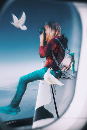Woman flying by sea