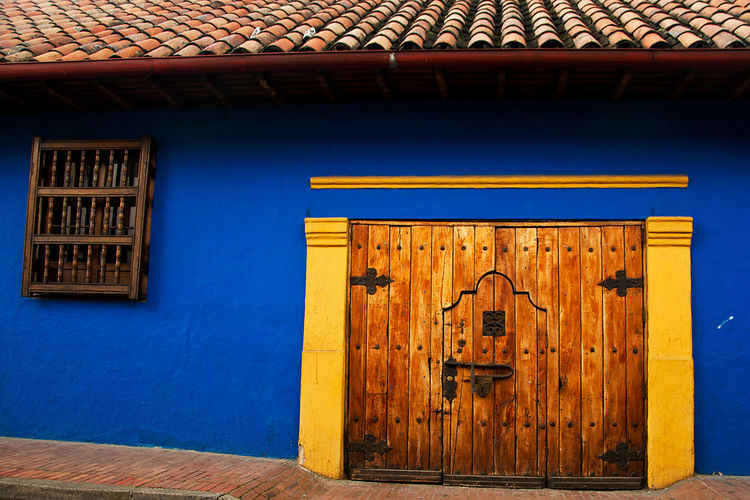 Closed Door Of Blue House In Town