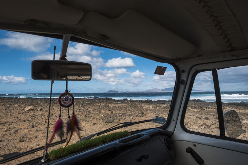 interior of minivan with dream catcher and ocean outside Old Van Car Car Interior Cloud - Sky Day Different Vacation Dream Catcher Horizon Over Water Land Vehicle Landscape Lifestyles Mode Of Transport Nature One Person Outdoors People Real People Sea Sky Transportation Vehicle Interior Water Window Windshield