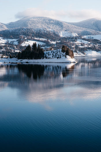 Picture taken at Colibita, Romania. Winter of 2019. Beautiful sunrise, beautiful weather, clear sky, blue water. www.instagram.com/pontosanpele Lake Blue Water Blue Blue Lake Lake Mirror Mirror Romania Transylvania Europe Travel Winter Landscape Winter Snowy Snow Snowy Trees Island House On An Island House Clouds Sunrise Sunrise_sunsets_aroundworld Beautiful Nature Beautiful Snowcapped Mountain Beauty In Nature Cold Temperature Scenics - Nature