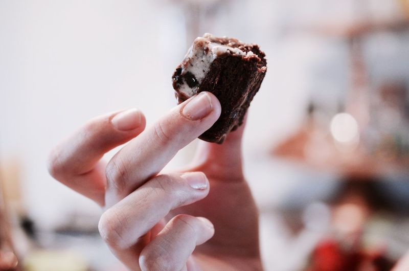 Cropped image of person holding dessert