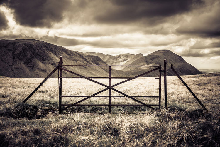 The Lake District is littered with relics of times gone by, in this case a lonely gate gate remains of which formed part of a vast fence system for controlling livestock on the fells. Cumbria, UK - Lake District National Park. Beauty In Nature Cloud Cloud - Sky Cloudy Countryside Farming Fence Field Gate Idyllic Lake District Landscape Mountain Mountain Range Nature Outdoors Relic Remote Rural Scene Scenics Security Sky Solitude Tranquil Scene Tranquility The Secret Spaces Long Goodbye The Secret Spaces
