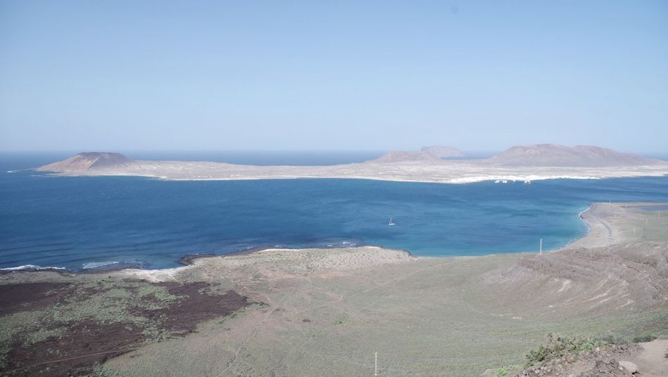 playa del risco and la graciosa, northern lanzarote. Beach Beach Life Beauty In Nature Clear Sky Coastline Day High Angle View Island La Graciosa Landscape Lanzarote Mountain Nature Nature Reserve No People Outdoors Playa Del Risco Sand Scenics Sea Sky Water Waterfront