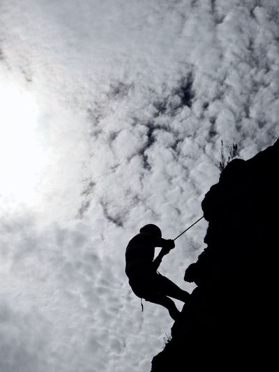 Extreme Sport against Extreme Clouds Silhouette Climbing Clouds Contrast Leisure Activity Rock Climbing Extreme Sports Adventure Real People Rock