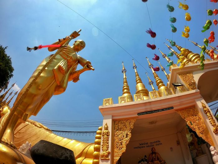 Low Angle View Sky Built Structure Representation Architecture Art And Craft Spirituality Belief Creativity Religion Human Representation Sculpture Nature Building Exterior No People Day Place Of Worship Statue Gold Colored Building