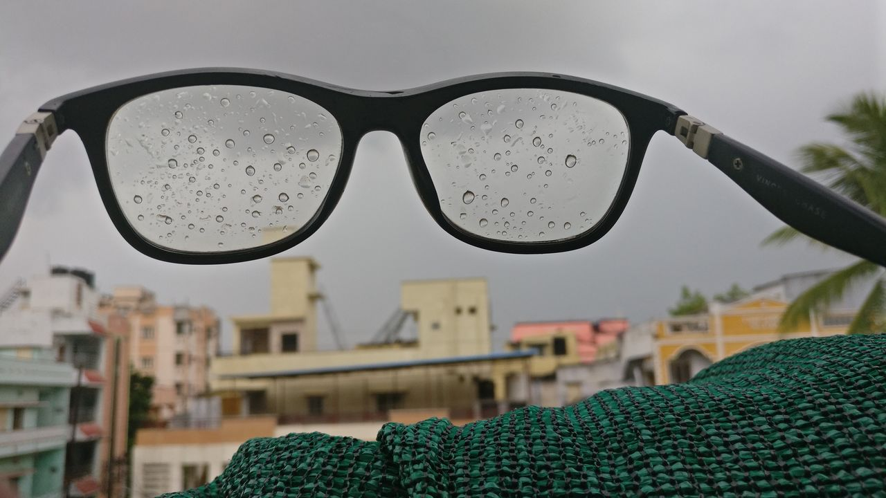 sunglasses, focus on foreground, eyeglasses, close-up, no people, day, drop, sky, eyewear, outdoors, water