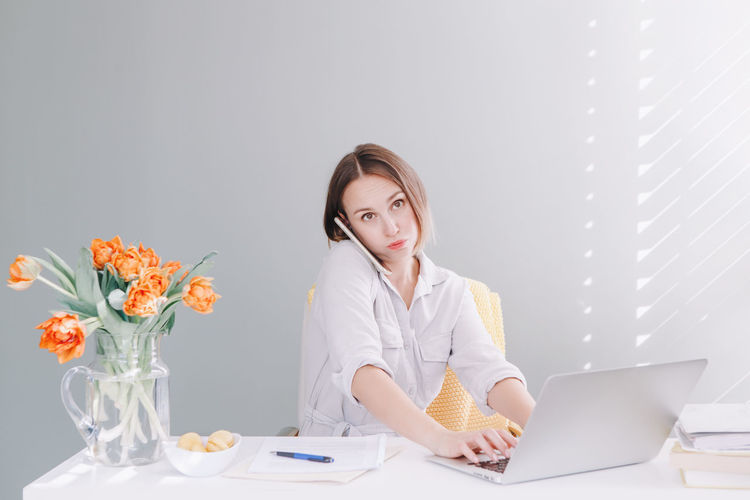 Tired middle age woman at desktop table working on laptop computer. work business from home