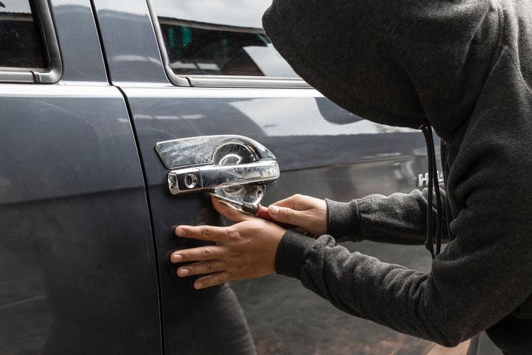 Burglar breaking car door