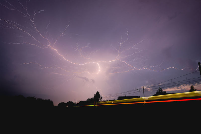 Forked Lightning Against Purple Sky At Night
