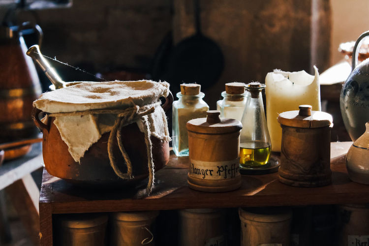 Table Still Life No People Indoors  Food And Drink Food Container Focus On Foreground Close-up Freshness Wood - Material Jar Drink Choice Household Equipment Bottle Refreshment Old Day Large Group Of Objects Glass Temptation Tray Medieval Kitchen Utensil Bottles
