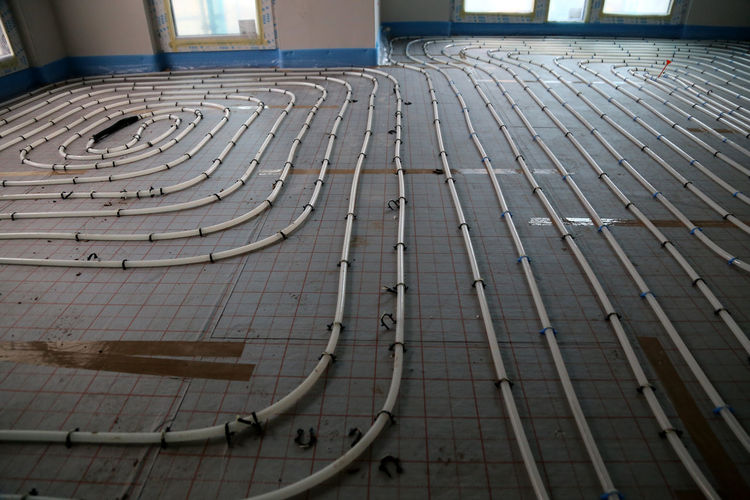 Floor heating tubes laid out to be covered by screed Curve Day Diminishing Perspective Floor Heating Fussbodenheizung Heating System Home Owner In A Row Neubau New Building  No People Renewable Energy Repetition Saving Energy Surface Level