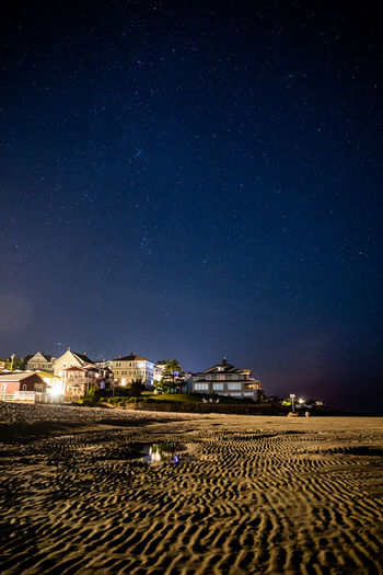 Scenic view of beach against sky at night