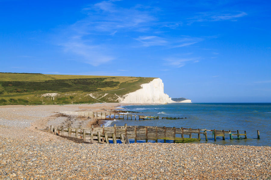 The Beach at Cuckmere Haven Beach Beauty In Nature Blue Chalk Chalk Cliffs Clear Sky Cliffs Cuckmere Haven Day Horizon Over Water Landscape Nature No People Outdoors Pebble Beach Scenics Sea Seven Sisters Sky Sussex Tranquil Scene Water White Cliffs