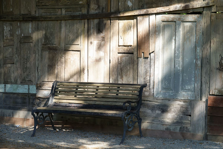 Empty bench wood with wooden backdrop Wood - Material Seat Architecture Built Structure Bench Old No People Empty Absence Building Day Weathered Abandoned Wall - Building Feature Building Exterior Outdoors House Piano Nature Bench