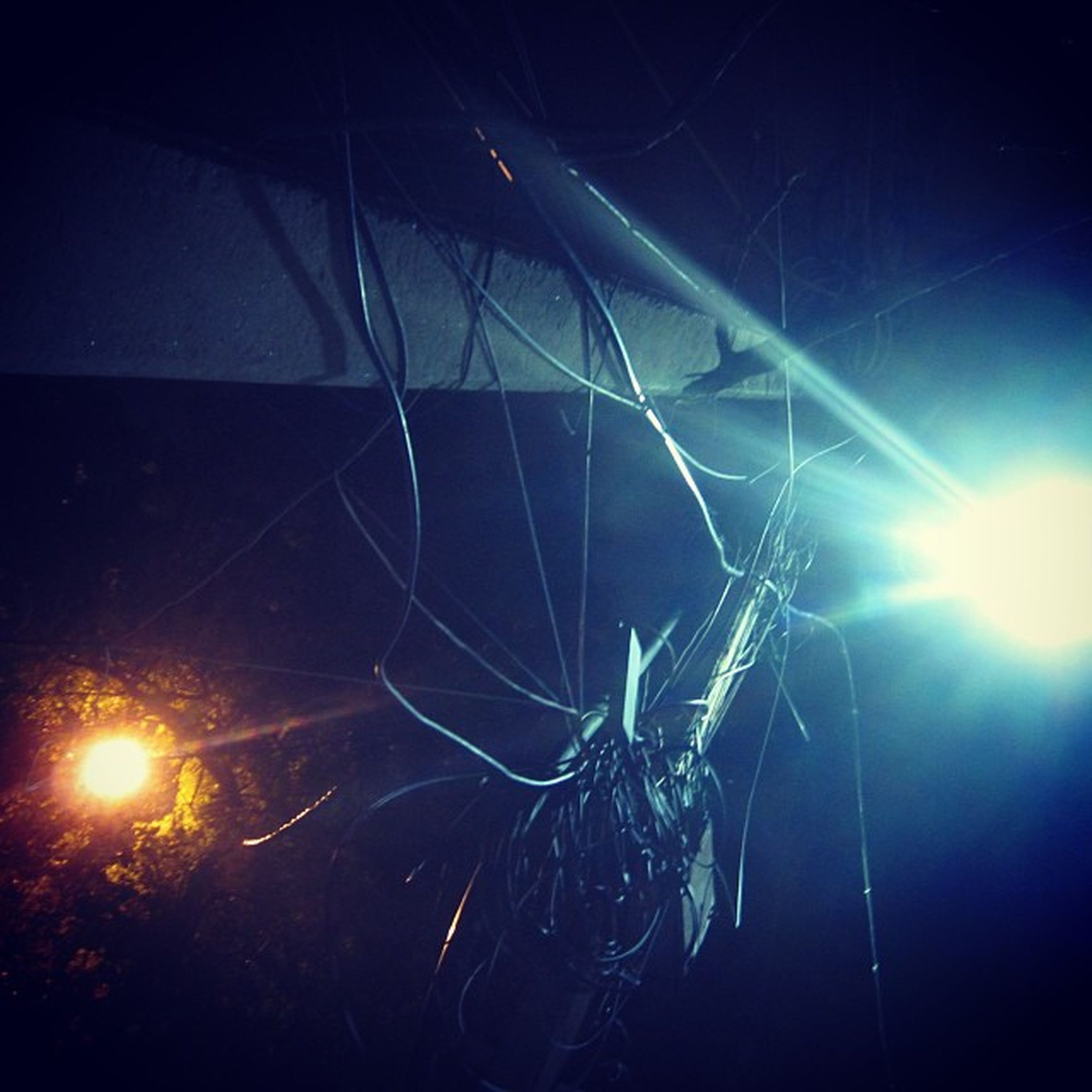 spider web, night, low angle view, illuminated, electricity, glowing, close-up, complexity, spider, indoors, no people, lighting equipment, lens flare, light - natural phenomenon, silhouette, sky, light, pattern, nature