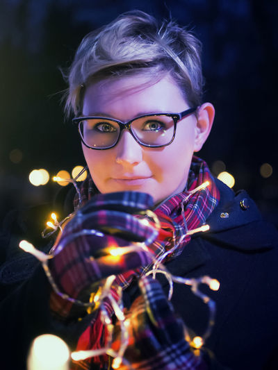 Christmas Lights Black Background Eyeglasses  Fairy Lights Front View Glasses Headshot Illuminated Looking At Camera Night One Person Outdoors Portrait Real People Young Adult Young Women