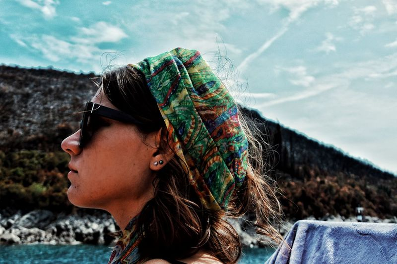 Portrait of young woman looking away outdoors