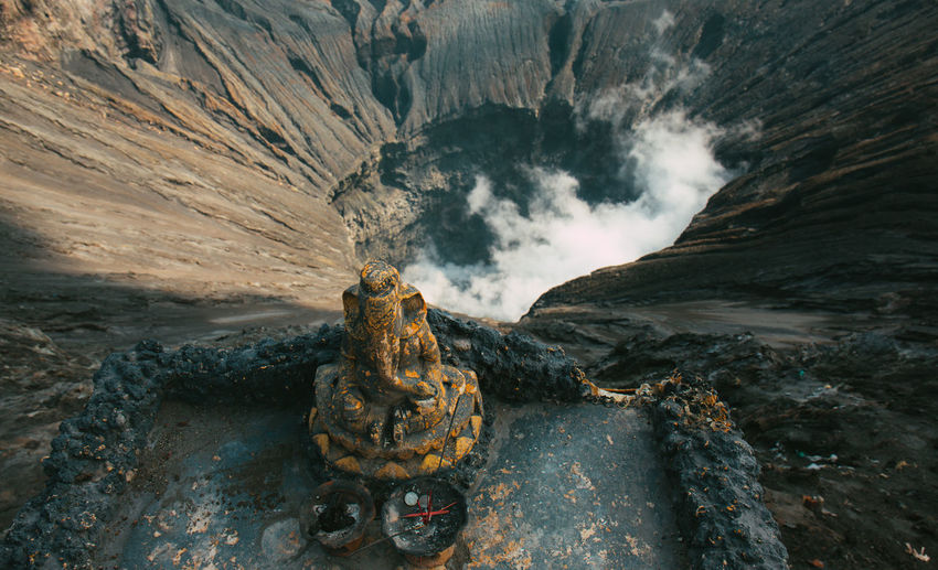 Close-up of ganesha statue against volcanic crater