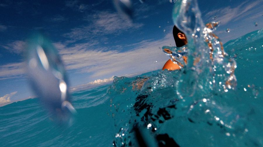 Close-up of person swimming in sea