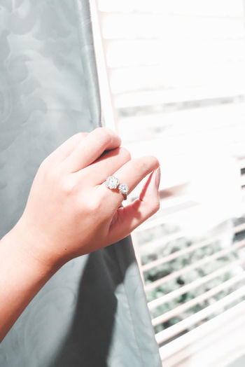 Close-up of woman hand holding ring