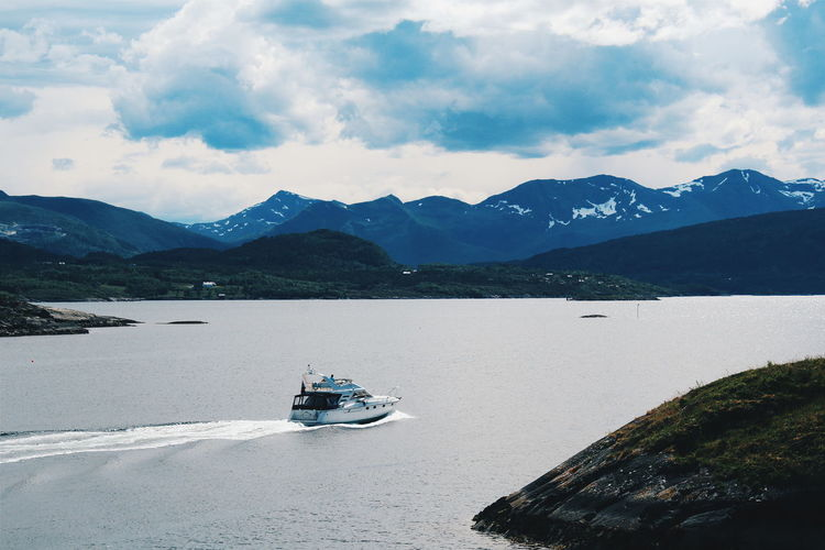 Norway Boat Boats Sea Water Nature Travel Mountain Range On The Move Journey Vacations Cloud - Sky Sky Beauty In Nature Travel Destinations Tourism Mountain Transportation Day Artic Country Norway WinterVibes Coldvibes Cold Capture