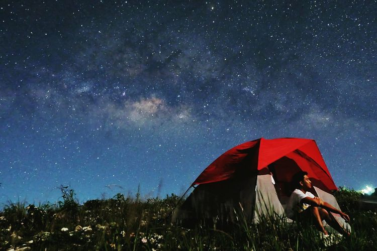 Tent against star field at night