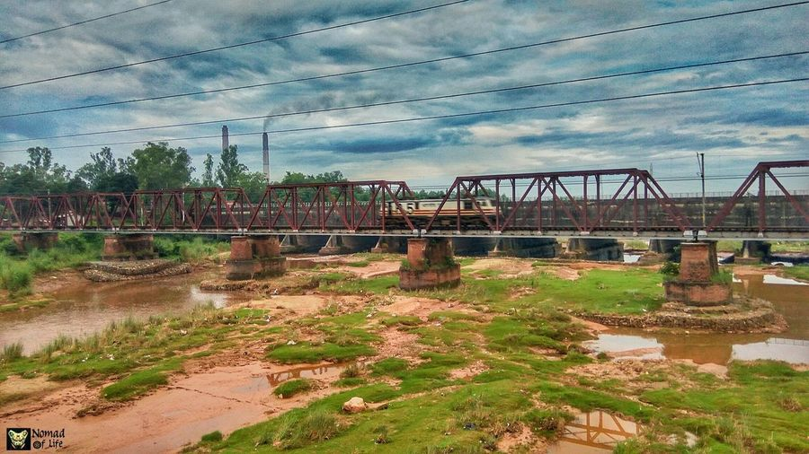 An electric locomotive engine on an old railway bridge 🇮🇳 Sky Cloud - Sky Outdoors No People Day Nature Grass Railway Bridge Locomotive Engine ExploreEverything Nature In The City Architecture Nomad EyeEm Eyeemphotography Building Exterior Photography Passion Wanderlust Highwayphotography Rainy Days☔ Landscape_Collection Landscape_photography India Indianrailways Traveldiaries