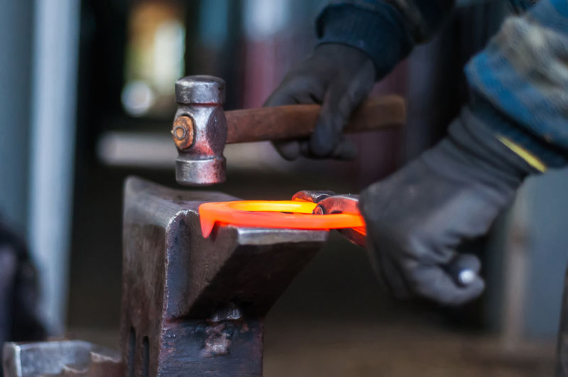 Blacksmith  Craft Focus On Foreground Hand Holding Human Body Part Human Hand Industry Iron - Metal Men Metal Metal Industry Motion Occupation One Person Real People Skill  Steel Work Tool Working Workshop