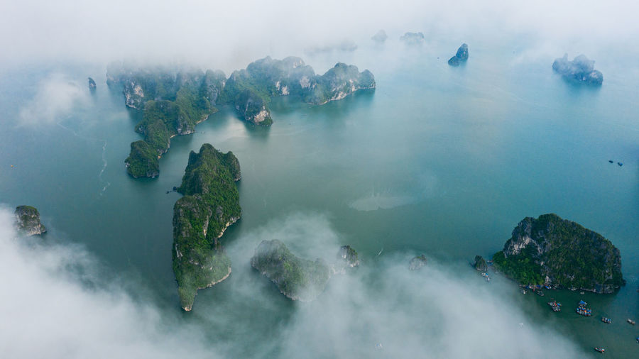 Ha Long Bay Ha Long Bay Cruise Sea Seascape Island Boat Beauty In Nature Scenics - Nature Water Aerial View Tranquil Scene Fog Land Tranquility Rock Solid