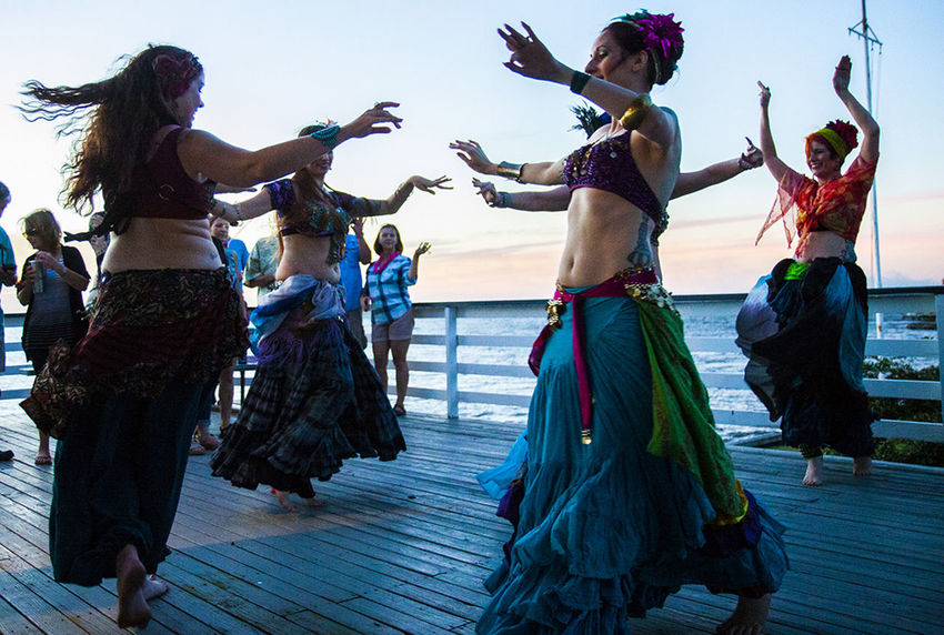 Adult Adults Only Arts Culture And Entertainment Beach Bellydance Bellydancers Cultures Dance Dancing Day Exotic Friendship Human Body Part Only Women Outdoors People Performance Performers Real People Silhouette Teamwork Vibrant Color Women Young Adult