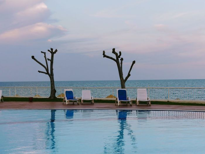 perfect happiness Hotel View Swimming Pool Sea And Sky Seaside Tranquility Sunset_collection Tree Trunk Swimming Time Happy Time Resort Poolside Lounge Chair Calm Infinity Pool Tranquil Scene Waterfront Idyllic Sunset Postcard The Traveler - 2018 EyeEm Awards