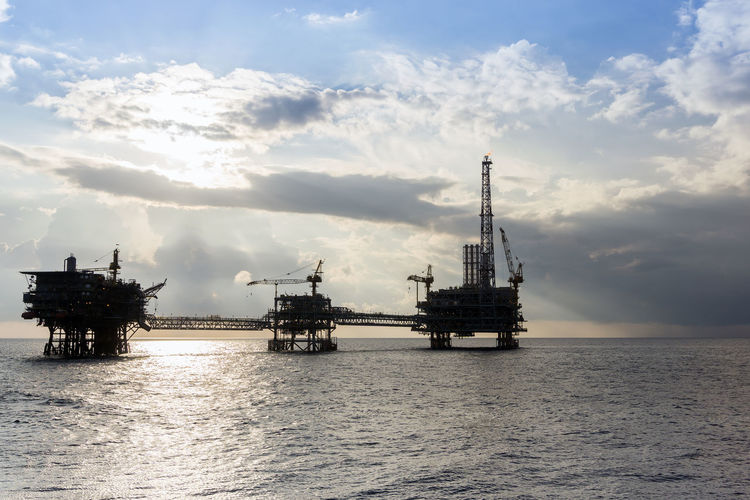 an evening at oil field Oil Rig Evening Sunset Petroleum Upstream Oil And Gas Ocean Horizon Over Water Wave Cloudy Offshore Offshore Life Drilling Rig Oil Pump Offshore Platform Oil Industry Sea Water Technology Silhouette Business Finance And Industry Oil Field Crude Oil Fossil Fuel Oil Oil Well