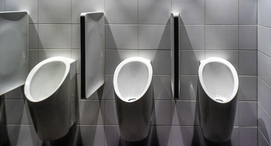 Close-up of urinals in restroom