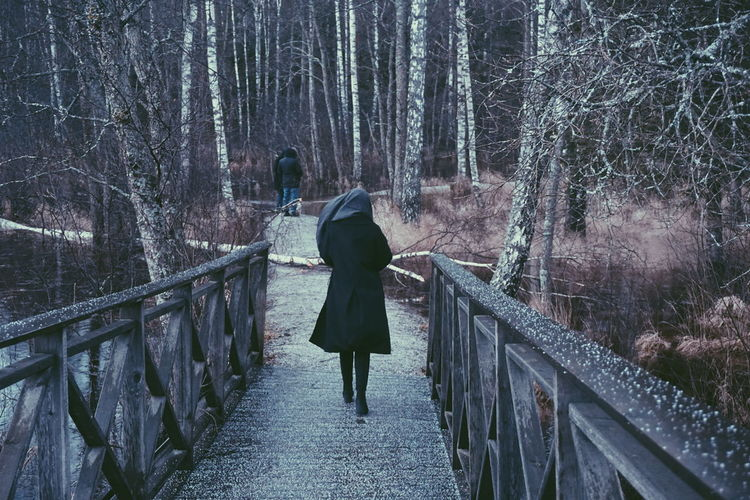 Hail storm and young woman walking on a bridge Walking Bridge Hail  Hailstorm Hailing Cold Cold Temperature Windy Winter Outdoors Railing Walking Real People Full Length Rear View Lifestyles Tree Outdoors Leisure Activity Women Nature People