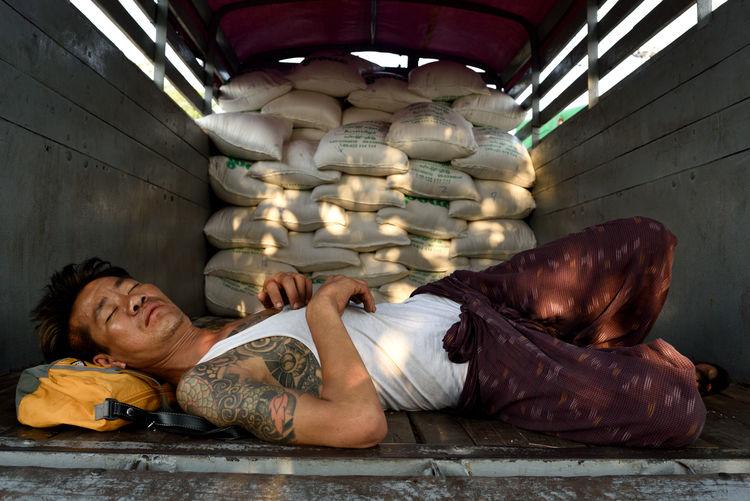 Afternoon nap in Yangon Burma Lorry Lying Down Myanmar Nap Rice Sacks Shade Street Photography Tattoo Yangon The Street Photographer - 2017 EyeEm Awards